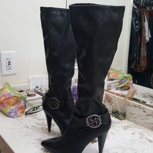 Black BCBG Generation High heels boots. They have